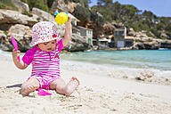 Spain, Baleares, Mallorca, baby girl playing on sandy beach - ROMF000048