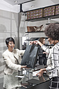 Woman shopping in luxury boutique - ZEF007001