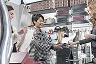 Woman shopping in luxury boutique - ZEF006671