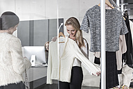 Woman shopping for clothes - ZEF006679