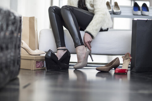 Woman trying on new shoes - ZEF006702