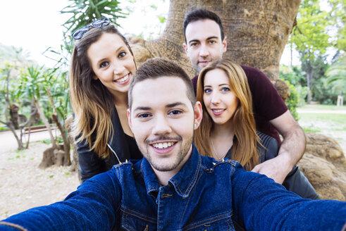 Four friends taking a selfie in a park - GEMF000243