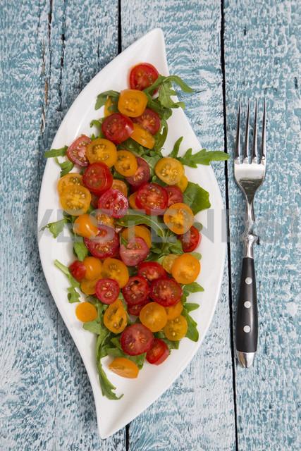 Leaf-shaped plate of tomato salad garnished on rocket - SARF001936