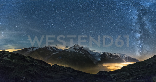 France, Mont Blanc, Lake Cheserys, Milky way and Mount Blanc by night with the valley lighted by the lights of the town of Chamonix - LOMF000007 - Lorenzo Mattei/Westend61