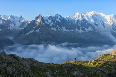 France, Mont Blanc, Lake Cheserys, hiker in front of Mount Blanc at sunrise - LOMF000026