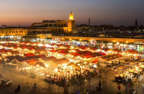 Morocco, Marrakesh, view to lighted Jemaa el-Fnaa bazaar in the evening - JUNF000319