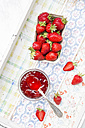 Glass of strawberry jam and box of strawberries - LVF003560