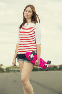 Portrait of woman with skateboard - TAM000159