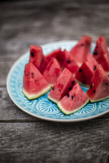 Chopped watermelon on blue plate - SARF001980