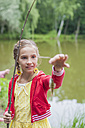 Germany, Girl with rod and small fish - MJF001541