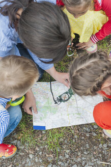 Germany, Children learning how to use compass and map - MJF001548