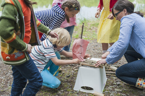 Germany, Children learning how to build a wooden raft - MJF001564