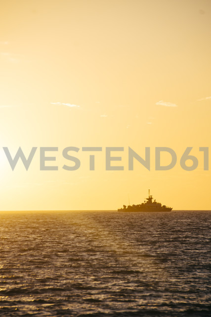 Greece, silhouette of warship at horizon seen from Paros by sunset - CHPF000151