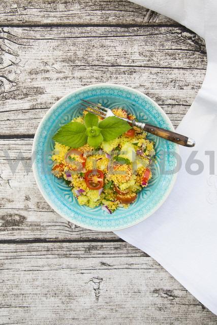 Bowl of couscous salad on wood - LVF003601