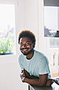 Portrait of smiling young in his kitchen - EBSF000696