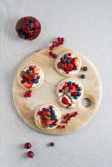 Pies with different berries on wooden board - MYF001058