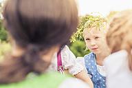 Germany, Saxony, portrait of little girl  wearing floral wreath - MJF001617