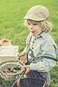 Germany, Saxony, portrait of little boy with basket of cherries - MJF001620