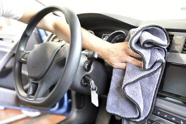 Man cleaning car interior - LYF000426
