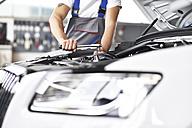 Mechanic repairing car in a garage - LYF000431