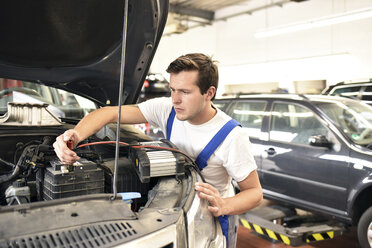 Mechanic repairing car in a garage - LYF000440