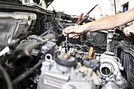 Mechanic repairing car in a garage - LYF000441
