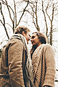 Young couple in love standinmg face to face in an autumnal park - CHAF000220