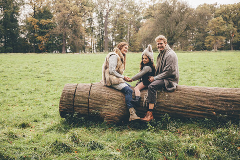 Happy family spending time together in an autumnal park - CHAF000233