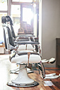Hairdresser chairs in a barber shop - MADF000355
