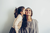 Daughter kissing smiling mother's cheek - CHAF000320