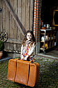 Smiling girl holding suitcase - CHAF000334