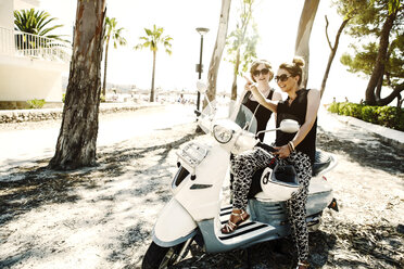 Spain, Majorca, Alcudia, two women with motor scooter - GDF000790