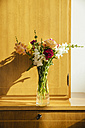 Small bouquet of summer flowers on wooden highboard - MFF001664