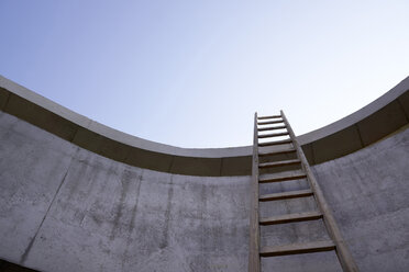 Ladder at concrete wall of an unfinished building - FMKF001579