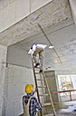 Two workers with ladder on construction site - FMKF001592