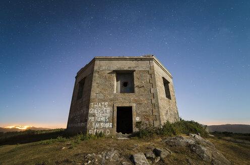 Spain, Galicia, Ferrol, Ruins of a former military building at night - RAEF000223