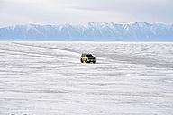 Russia, Lake Baikal, pickup truck driving on frozen lake - GNF001358