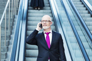 Germany, Berlin, Potsdam Square, business man with mobile phone - TAM000254