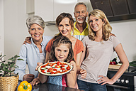Group picture of three generations family in the kitchen - MFF001738