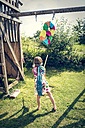 Girl with Pinata formed like an Eight in the garden - SARF002031
