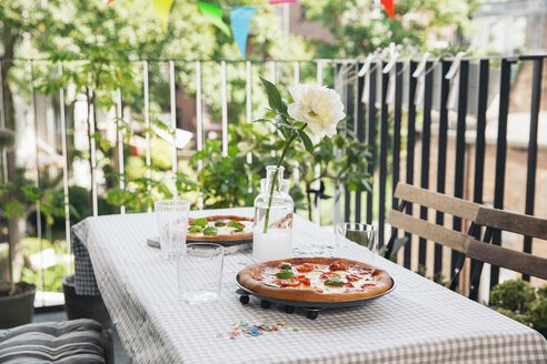 Homemade pizza on a laid table - MFF001752