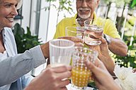 Family toasting with water and juice, close-up - MFF001781
