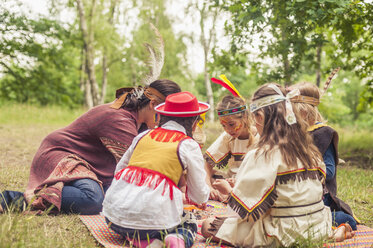 Germany, Saxony, Indians and cowboy party, Girls tinkering with beads - MJF001633