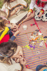 Germany, Saxony, Indians and cowboy party, Girls tinkering with beads - MJF001634