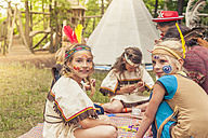 Germany, Saxony, Indians and cowboy party, Girls tinkering with beads - MJF001636