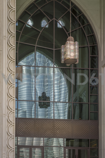 United Arab Emirates, Dubai, Burj Khalifa reflecting in the window of a traditional arabic styled building - NKF000276