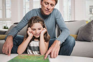 Father and little daughter with map in the living room - MFF001690