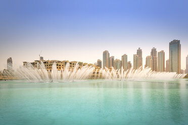 United Arab Emirates, Dubai, Fountain in the Burj Khalifa Lake with Souk Al Bahar - NKF000263