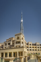 United Arab Emirates, Dubai, residential area at Souk al Bahar with Burj Khalifa in the background - NKF000272