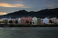 Austria, Tyrol, Innsbruck, colorful houses in front of Nordkette mountains - MKFF000235